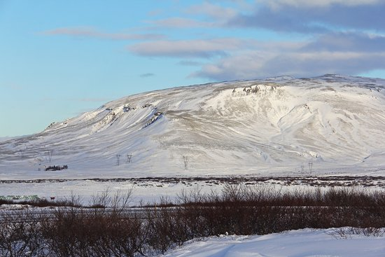 Selfoss, Iceland: And hidden within the vast whiteness, a frozen crater… @ Kerið volcanic crater