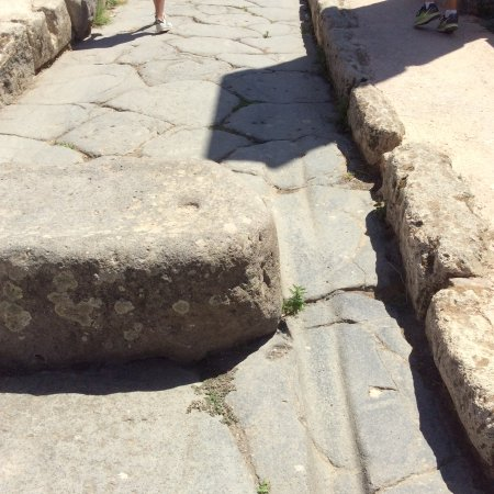Gaetano's Pompeii Tours: A road in the process of being repaved in 79AD (NB the wheel grooves).