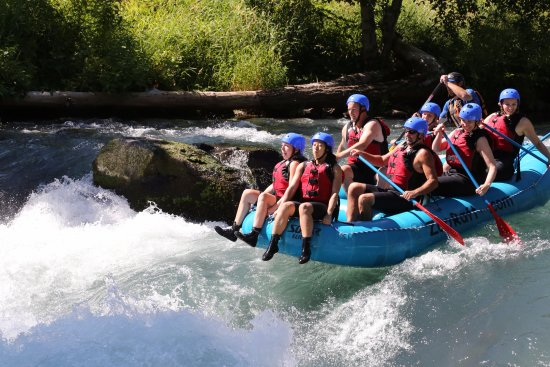 """White Salmon, วอชิงตัน: A fun optional thing they offer is """"riding the bull""""-sitting on the edge of the raft over the ra"""