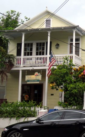 front of Tropical Inn