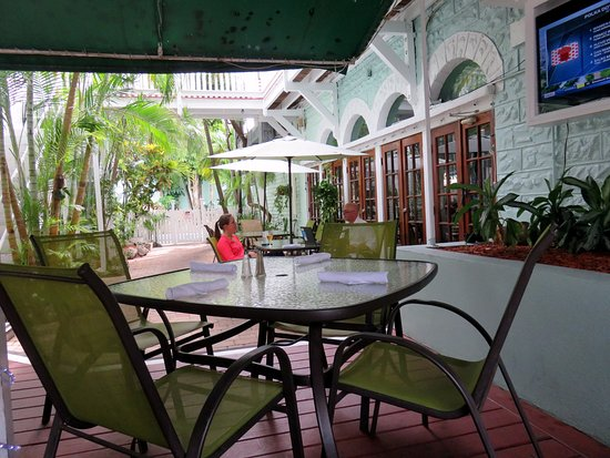 outdoor shaded porch and entrance Picture of Bogart s Irish Pub