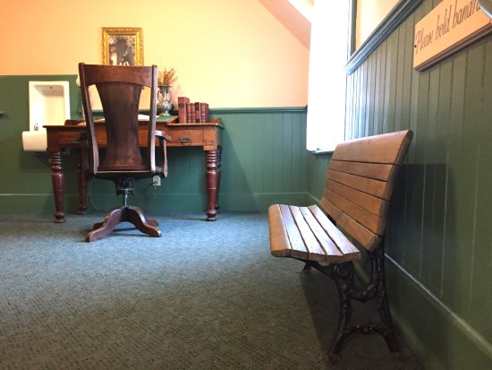 Lee, MA: school bench can be found in the hallway as well as old desks