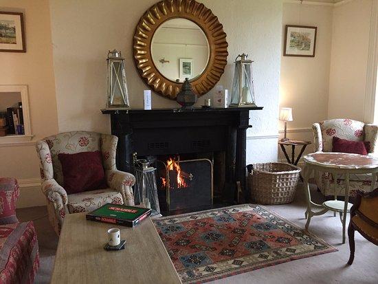 Prince Hall Country House: Prince Hall Hotel sitting room - log fire - July!