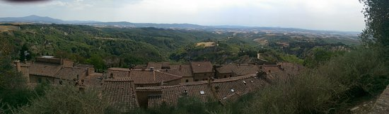 Asciano, Italy: View of Tuscany over the rooftops of Chiusura