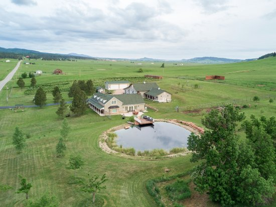 High Prairie Lodge: BIrd's Eye view of the Lodge and natural swimming pool.