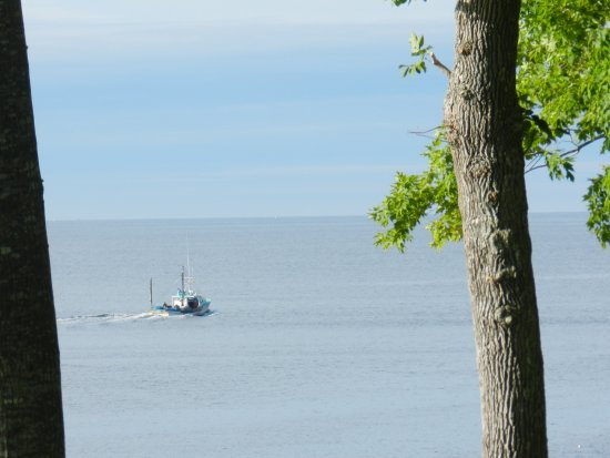 Lincolnville, ME: Watching the lobster boat from our cabin deck.