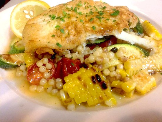 Armonk, NY: Special: salmon filet over fregula, corn, summer squash & grape heirlooms, vino bianco, thyme sa