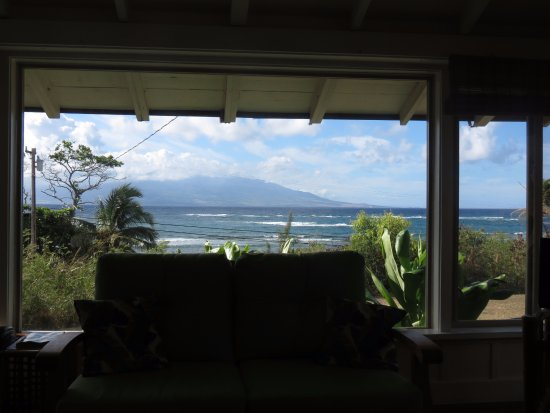 Kaunakakai, HI: The view from Sugar Mill Cottage overlooking the ocean with Maui in the background.