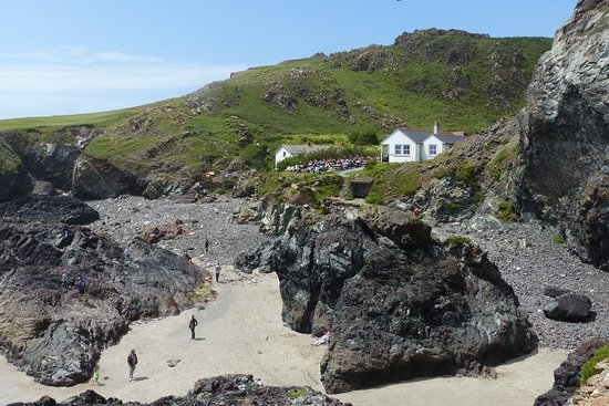 Lizard, UK: The cove and beach at low tide with the cafe in the background