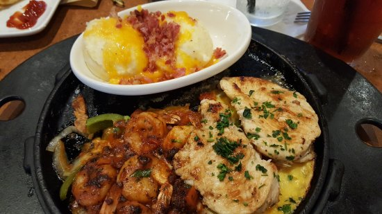 Conway, AR: Sizzling Chicken and Shrimp with loaded mashed potatoes.