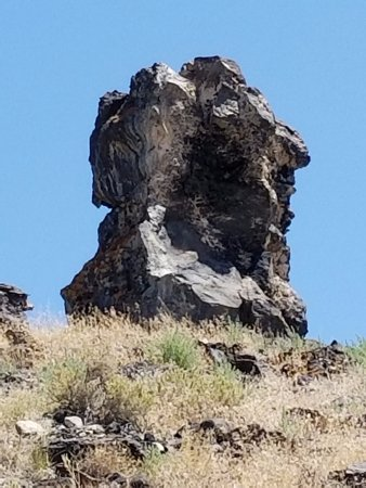 Delta, UT: This view is found by hiking up the hill toward the formation. Notice the seated woman in white.