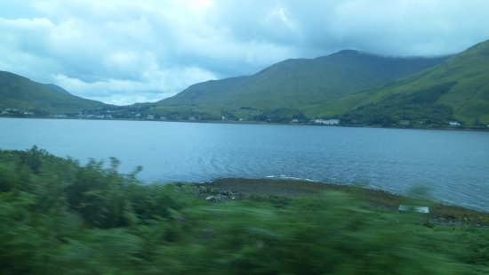 Leenane, Ireland: The hotel as seen from across Killary Harbour-- it's the large long white building.