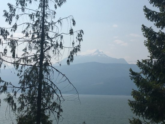 Nakusp, Canada: View of the lake and mountains through the haze from fire smoke