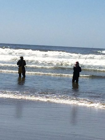 Cape Lookout State Park: Two of the three fishermen casting their lines
