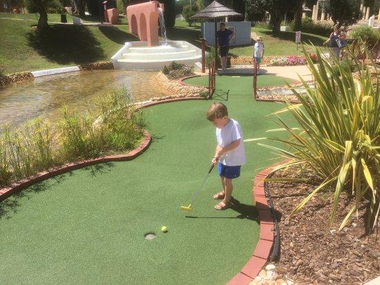 Family Golf Park: Our grandchild playing minigolf
