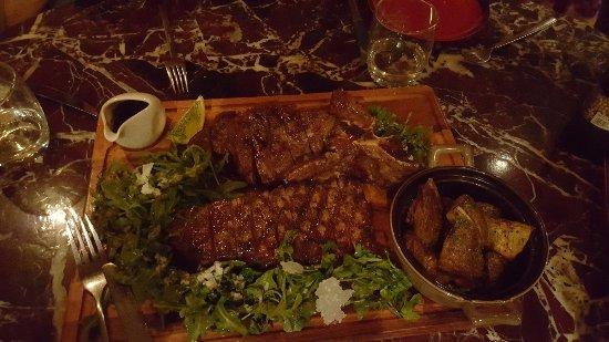 Prego: Huge T-Bone Angus Steak with Potatoes and Arugula Greens