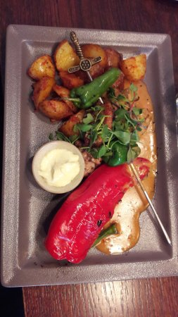 Pori, Finland: Chicken in a skewer, with patatas bravas potatoes, peppers, pepper sauce and aioli