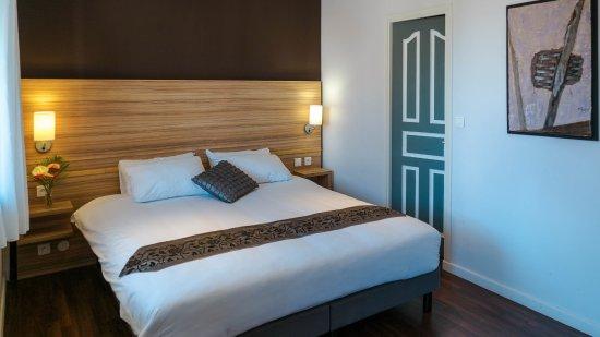 Chambre avec lit king-size à Eclipse - Photo de Eclipse, Cayenne ...