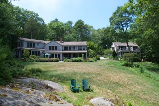 Georgetown, ME: View of Coveside's main house and cottage house from the water