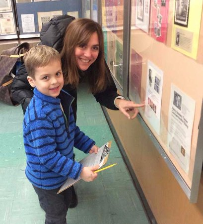 Weston, MA: Mom and son look for clues in one of the exhibits