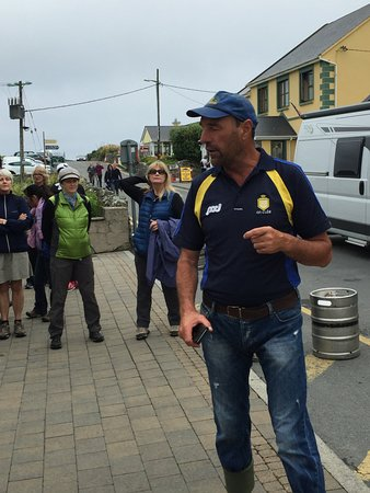 Doolin, Ireland: Pat gives intro at our starting place across from O'Connor's pub.