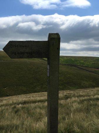 Settle, UK: Sign post to Ingleborough