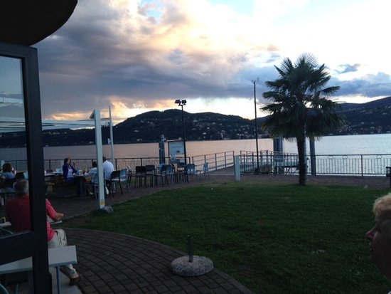 Ranco, Italia: Outside dining area and ferry jetty