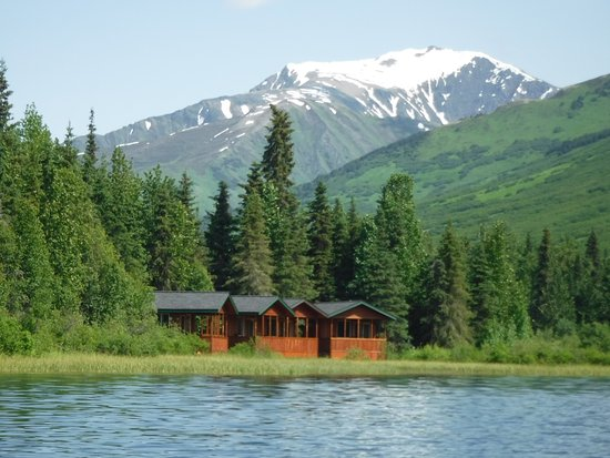 Moose Pass, AK: View of waterfront cabins taken from the canoe on the lake.