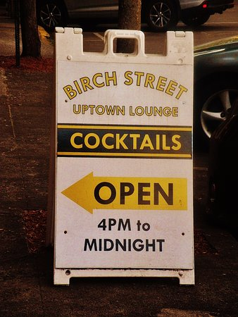 Camas, WA: sidewalk sign with hours for the lounge
