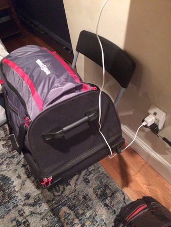 Folding chair used as luggage rack TVWifi wiring Picture of