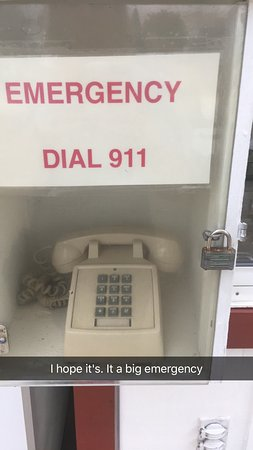 Bristol, WI: This outside the office. It has a plexiglass door and is locked. Labeled Emergency phone.