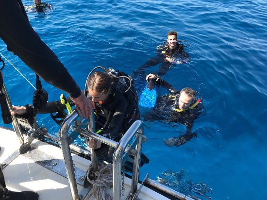 Munxar, Malta: Exiting the water after boat dive to comino