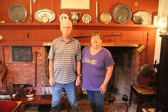 Cherryfield, ME: Us in front of huge fireplace in dining room at Englishman's B & B