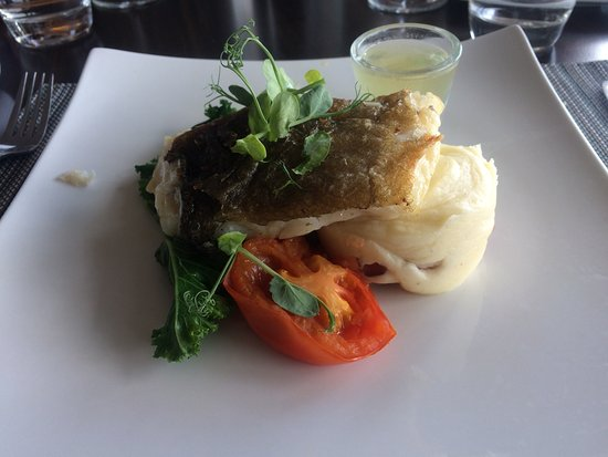 Toulouse Restaurant: My baked cod with the smoked bacon potato....mmmmmm