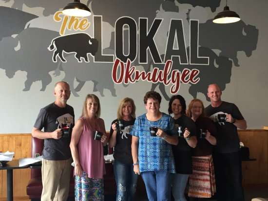 Okmulgee, OK: The OHS Class of 1975 donates coffee mugs to The Lokal