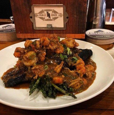 Greenville, NC: Blackend NC catfish smothered in crawfish etoufee.