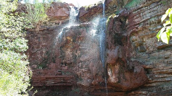 High Rolls Mountain Park, NM: The water falls over red sandstone. Beautiful!