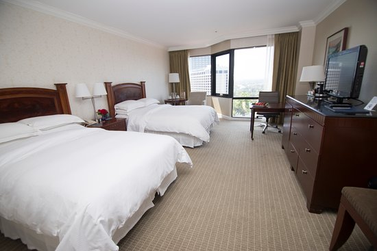 Hilton Los Angeles/Universal City: Our guest room with two double beds includes a flexible work environment and HDTV.