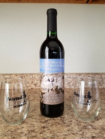 Our souvenir bottle of wine  and glasses from Twisted Pine Winery