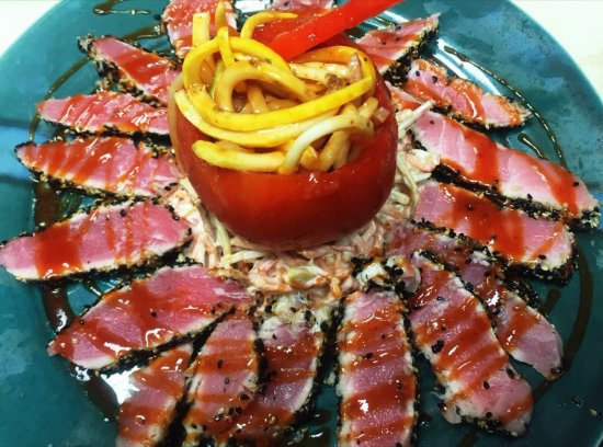 Lebanon, TN:  Stuffed Tomato with Seared Tuna Sitting on a bed of sweet potato slaw, stuffed with fresh veget