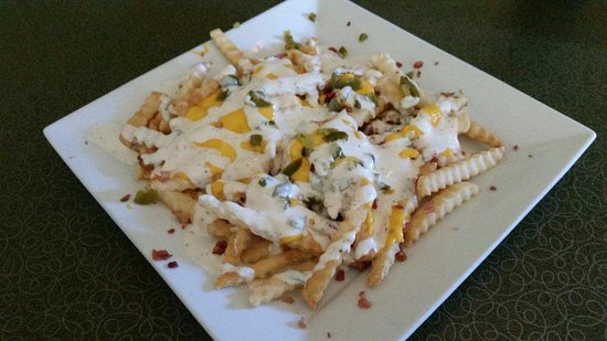 Monroe, WI: Loaded Fries, nacho cheese, jalapeno, ranch dressing and bacon bits