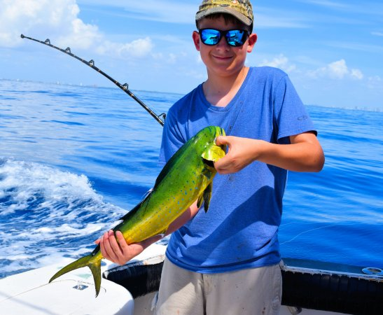 Danny with his first mahi picture of sea cross miami for Deep sea fishing trips florida