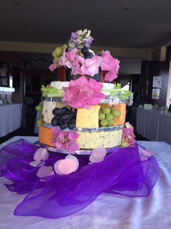 The fairways restaurant:   Our wedding cake made from different cheeses interspersed with grapes and flowers from our gar