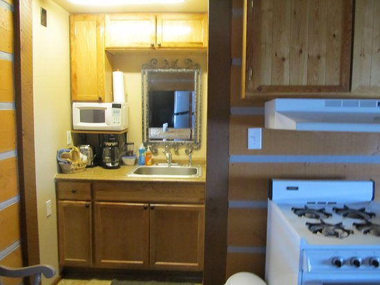 Pine Haven, WY: Deluxe kitchenette cabins with baths - equipped with apartment size refrigerators, coffee makers