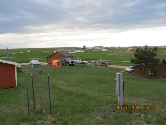 Pine Haven, WY: Pitch a tent outside your cabin which also has a patio, grill & picnic tables