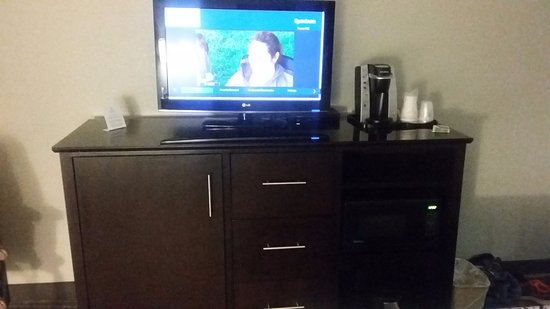TV with coffee maker and storage space