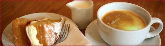Newent, UK: Fresh cream & jam sponge, with a lovely americano.