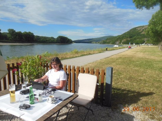 Gasthof Zum Goldenen Anker: Reading our email by the Danube with refreshing cold beer.