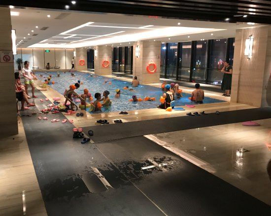 Jingzhou, China: Selling tickets to the pool for USD 1.00, overcrowded pool