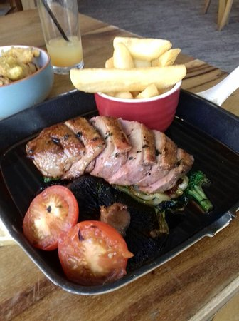 Cottingham, UK: Duck breast on a bed of pak choi and broccoli with chunky chips